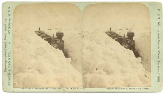 Black and white photograph of a snow blockade, Southern Minnesota Division, Chicago, Milwaukee and St. Paul Railway, March 29, 1881.