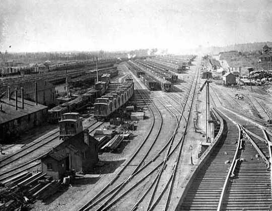 Black and white photograph of the large classification yard and part of the shops complex at Proctor, 1900.