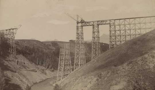 Black and white photograph of the Great Northern Railway trestle over Two Medicine in course of construction, ca. 1877.