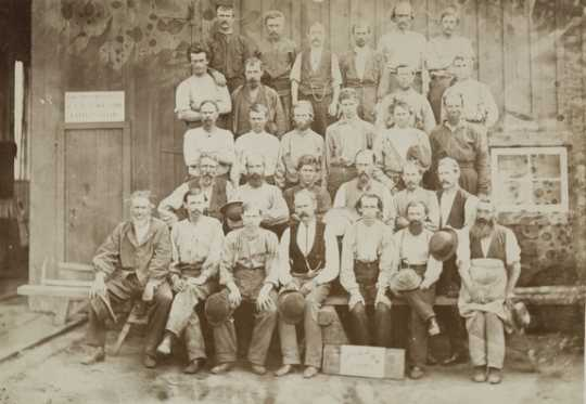 Black and white photograph of St. Paul and Pacific Railroad employees, 1873. Photographed by Redington & Shaffer.
