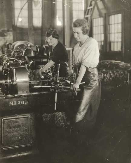 Black and white photograph of women handling lath machines in Northern Pacific Railway's Como Shops, ca. 1920.