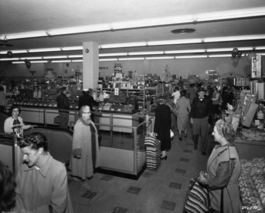 Black and white photograph of the interior of the Woolworth's store at Southdale shopping center on opening day in 1956.