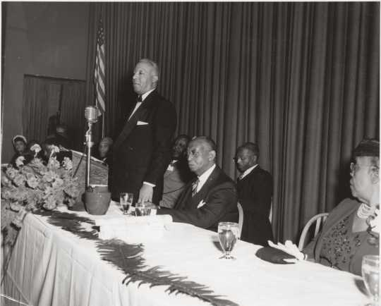 Black and white photograph of a Frank Boyd testimonial dinner, with A. Philip Randolph standing, 1951.