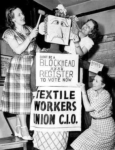 Textile Workers Union of the Congress of Industrial Organizations urging members to register to vote Photograph by Lee & Palmer, 1948.