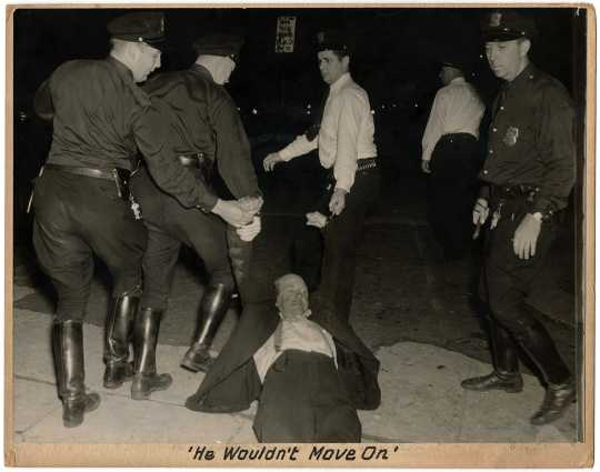 Police dragging a striking worker