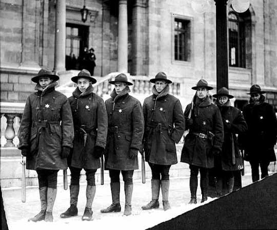 Black and white photograph of Home Guardsmen on duty outside the St. Paul Public Library during the Street Railway union rally in Rice Park, December 2, 1917.