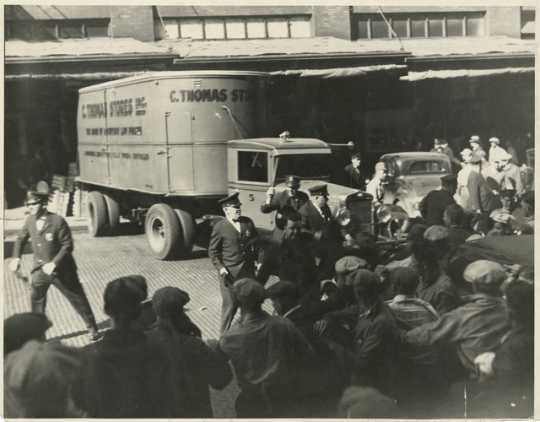 Black and white photograph of police and strikers, 1934.