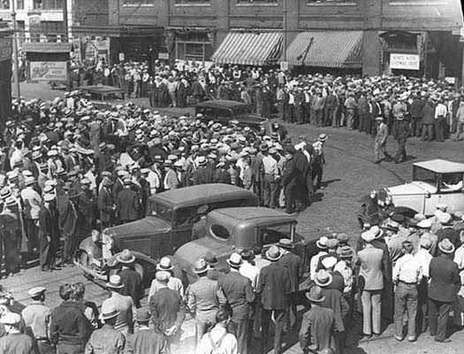 Black and white photograph of a street scene, Truck drivers' strike, 1934.