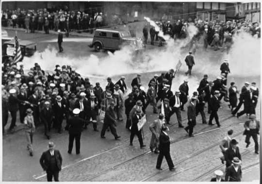 Black and white photograph of tear gas being used on demonstrators during the truck drivers' strike, 1934.