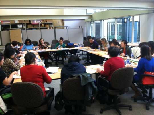 Color image of a meeting of the Hmong Health Care Professionals Coalition, 2013.