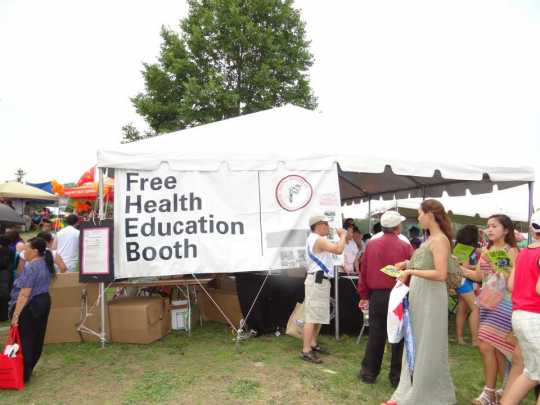 Color image of the Hmong Health Care Professionals Coalition Health Fair , 2013.