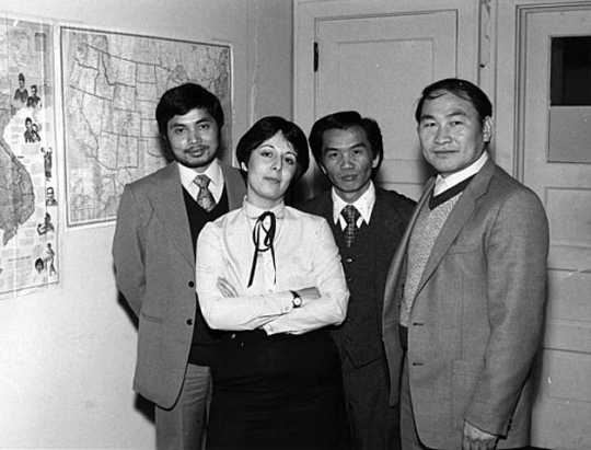 Black and white photograph of staff at Lao Family Community, Saint Paul, Ramsey County, 1981.