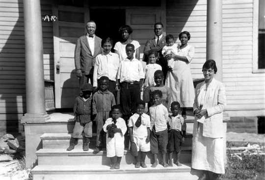 Black and white photograph of children on steps of Phyllis Wheatley House, ca. 1925.