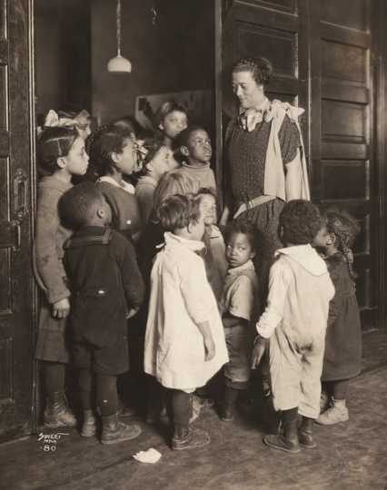 Black and white photograph of Gertrude Brown with children at Phyllis Wheatley House, ca. 1924.