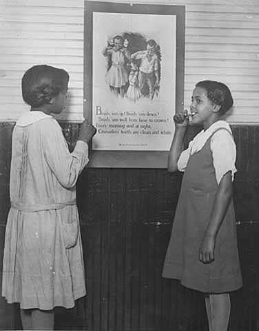 Black and white photograph teaching good health habits, Phyllis Wheatley House, ca. 1920.