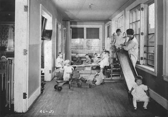 Black and white photograph of children playing at the Neighborhood House, c.1925.