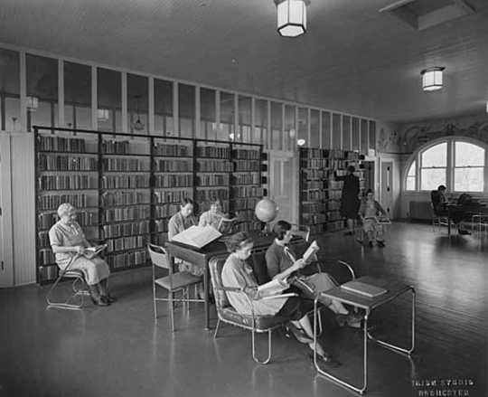 Black and white photograph of women reading in library, Rochester State Hospital, c.1930.
