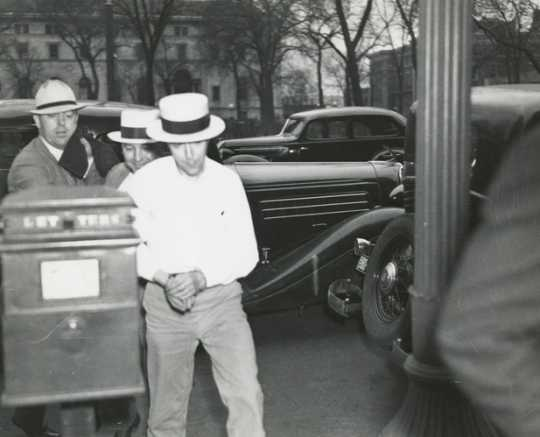 Black and white photograph of Alvin Karpis captured by federal agents and brought to St. Paul in connection with the Hamm and Bremer kidnappings, 1936.