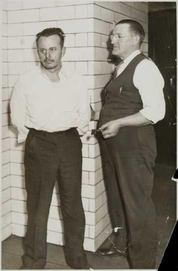 "Arthur ""Doc"" Barker, left, with jailer, William Gates"