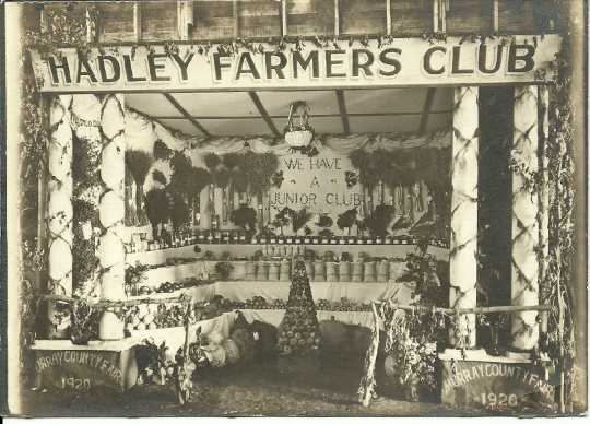 Black and white photograph of the Hadley Farmers' Club booth at the Murray County Fair, 1920.