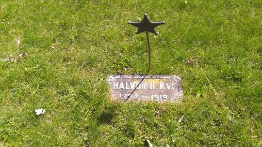 Halvor H. Quie's headstone, undated. It uses the original Norwegian spelling of his surname: Kvi. Used with the permission of the photographer, Jeff M. Sauve.