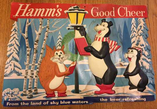 """Photograph of """"Hamm's Good Cheer"""" holiday promotional sign featuring the Hamm's bear, little bear, and squirrel, mid-to-late 1950s."""