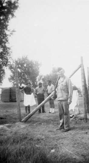 Black and white photograph of Harvey Fleshner guarding German prisoners of war in Moorhead, ca. 1943–1945.