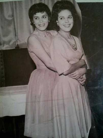 Black and white photograph of Hilda Simms (right) posed with one of her younger sisters, Laura, c.1955.
