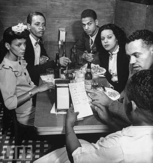 Black and white photograph of Hilda Simms with Earl Hollman and other actors from the Harlem Theater in New York City, c.1943.