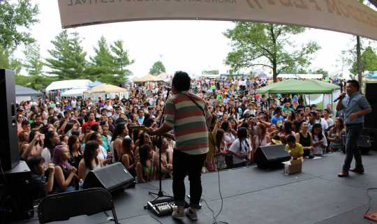 Color image of Hmong recording artists Kong and Shu perform at the 11th Annual Hmong Arts & Music Festival at Como Park in St. Paul, July, 2014.