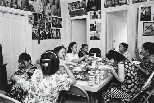Black and white photograph of a Hmong Celebration, Frogtown, 1993. Photograph by Wing Young Huie.