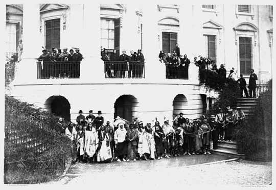 American Indian delegation in Washington, D.C.; Bagone-giizhig is standing on the balcony, to right of second pillar from the left