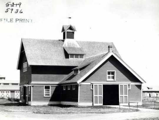Black and white photograph of the horse barn at the Northwest Experiment Station.