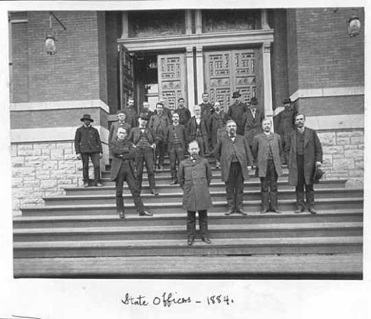 Minnesota state officers posed with Governor Lucius F. Hubbard