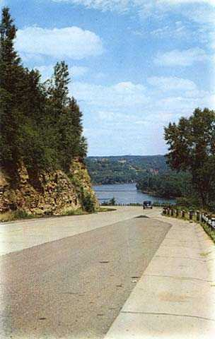 Color image of Highway 8 entering Interstate Park, Taylors Falls, MN, 1945.