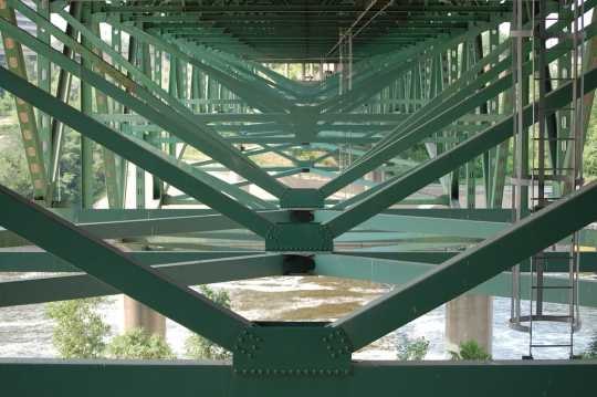 Underside of the bridge showing the deck truss construction and gusset plates. Photo by Flickr user ibran. BY-NC-ND 2.0