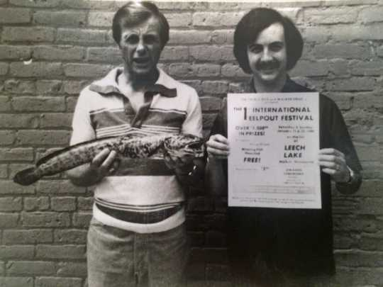 Ken Bresley (holding the eelpout) and Don Overcash, the founders of the International Eelpout Festival, promoting the first festival, 1980. Photo by Don Smith, Walker Pilot-Independent. Used with permission.