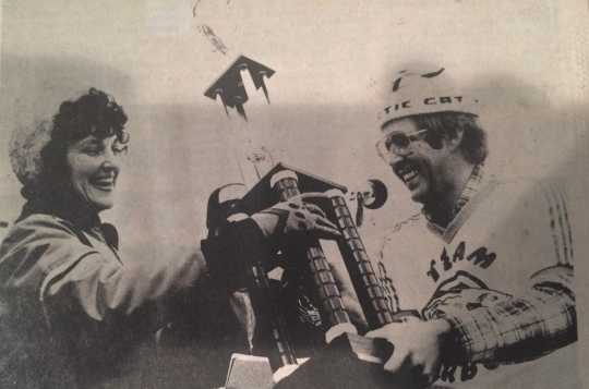 Diane Maas of Walker receives the first annual International Eelpout Festival trophy from Minneapolis Tribune sportswriter Ron Schara, 1980. Diane's prize-winning eelpout weighed in at eight pounds eleven ounces. Photo by Don Smith, Walker Pilot-Independent. Used with permission.