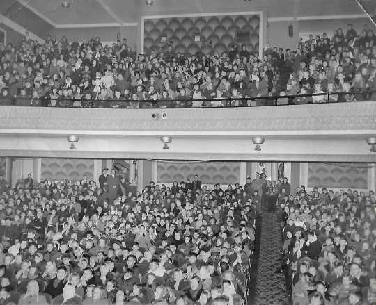 Black and white photograph of the Children at a Christmas matinee at the Grand Theater, ca. 1950s.