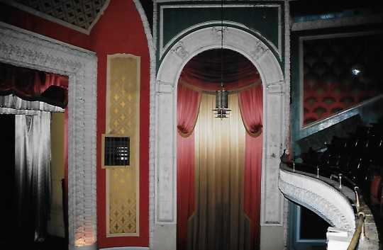 Color image of front of theater showing arch and edge of balcony, 2005.