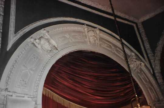 Color image of Muses in plaster on arch, 2005.