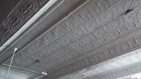 Color image of a metal ceiling in city chambers, second floor of Crookston city hall, 2016.