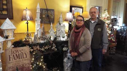 Color image of the owners of gift shop in old Crookston city hall, December 2016.