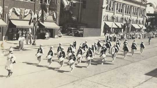 Black and white photograph of the American Legion drum and bugle corps on parade at state competition in Albert Lea, Minnesota, August, 1935.