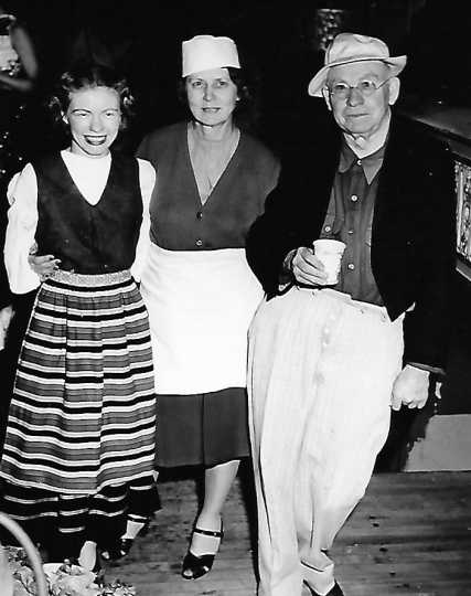 Black and white photograph of Marge McKenzie, Louise Hiller, and Charles Hiller at the Grand Theater, ca. 1940s.