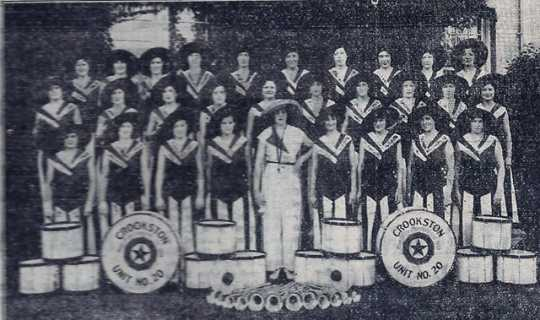Black and white photograph of the drum and bugle corps in pajama uniforms, 1930s.