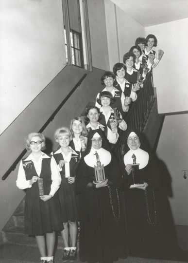 Black and white photograph of the debate team of St. Joseph's Academy in the late 1960s.