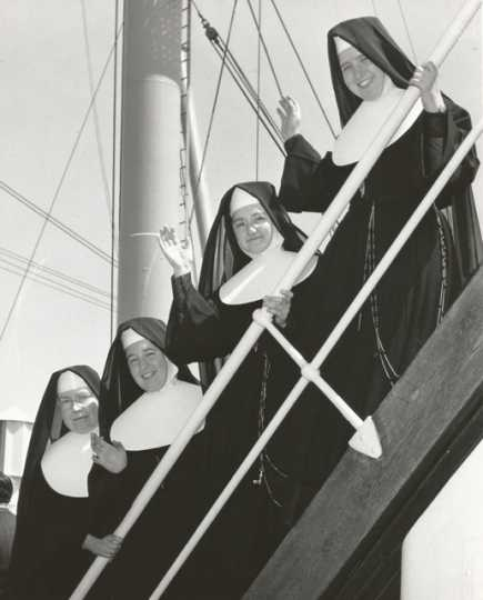 Black and white photograph of Sister Irmina Kelehan (bottom left) and other Sisters of St. Joseph setting sail for Japan, 1956.