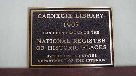 Color image of the sign on Carnegie Building, 120 North Ash Street, designed by Bert Keck, 2016.