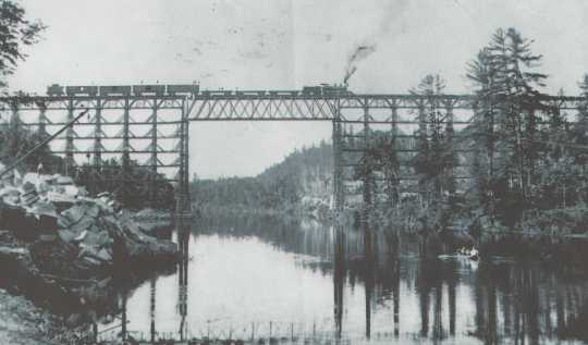 High bridge over the Kettle River near Sandstone before September 1, 1894, and before the trees in the area were cut down by a logging company, which left highly flammable debris (slash) to serve as fire fuel. Photograph Collection, Hinckley Fire Museum, Hinckley.